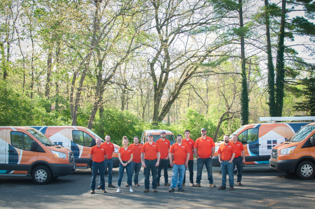 Quality Comfort Home Services installation and repair team